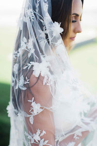Side portrait of bride wearing Iris bridal veil by Mauve et Blush embroidered with organza flowers and silver thread