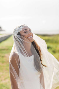 Bride laughing on her wedding day wearing Mauve et Blush Juliet Cap Veil