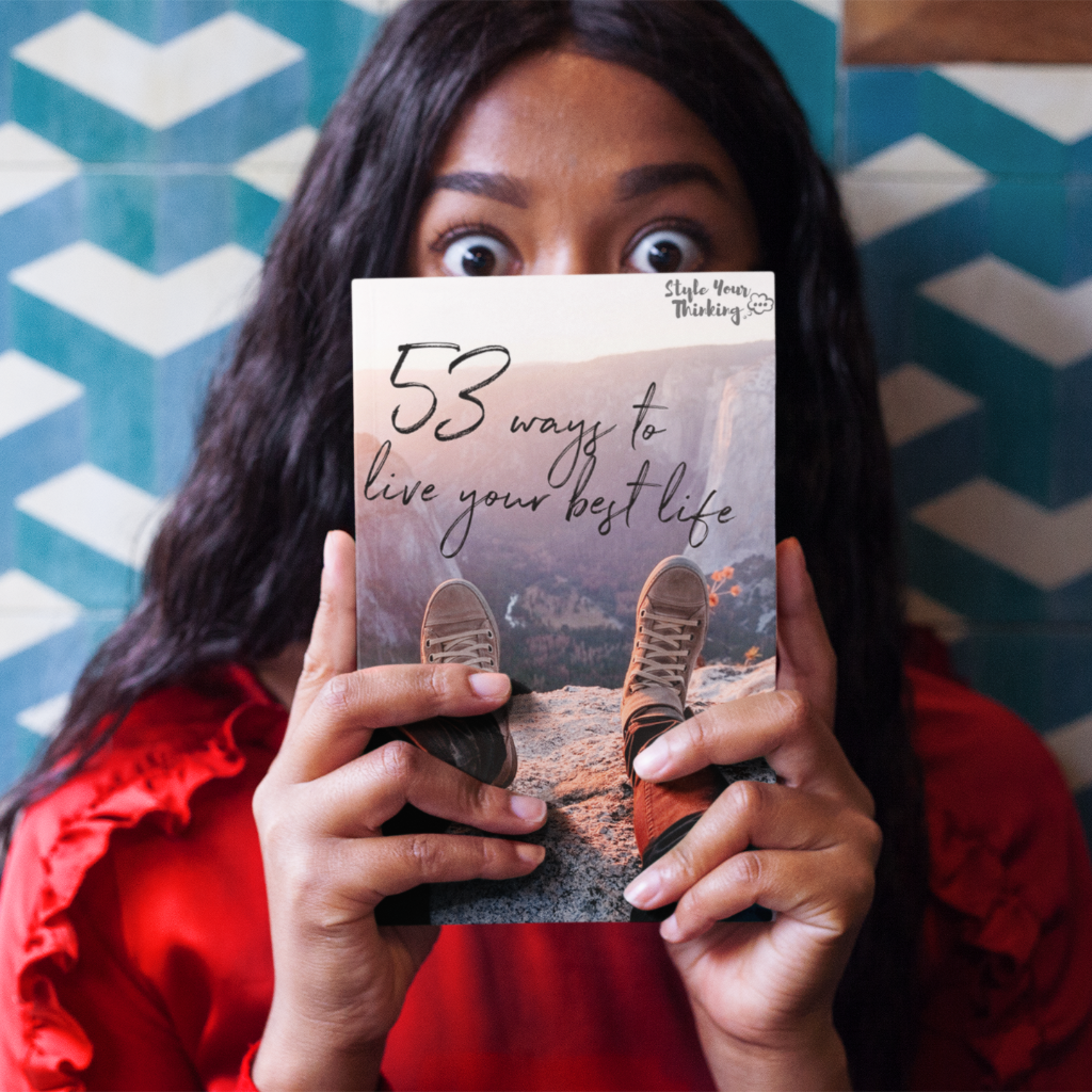 girl holding book 53 ways to live your best life