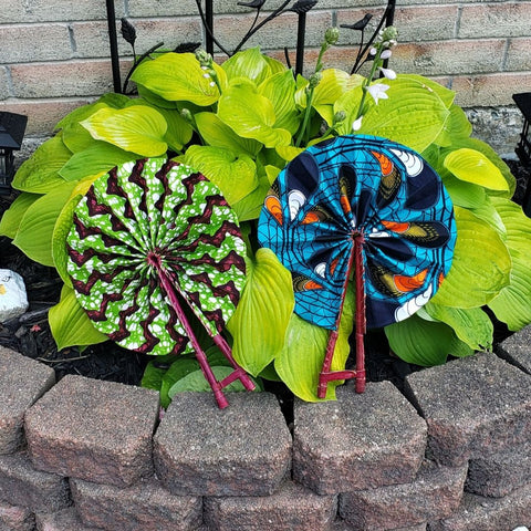 Green and pink African Print hand fan and a Blue and orange African print folding hand fan for summer. Kejeo Designs