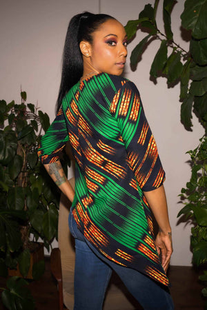 Load image into Gallery viewer, Women's tops for summer. Summer looks. Plus size women's top. Green top. Orange tops. African fashion.
