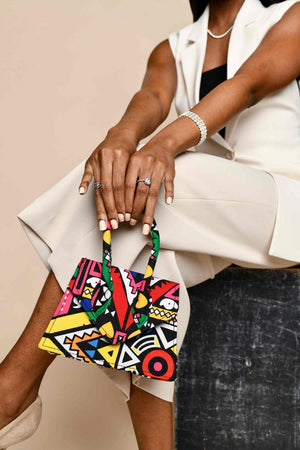Load image into Gallery viewer, african print mini bags. floral mini bags. luxury mini bags. african bags. pink mini bags. african inspired handbags
