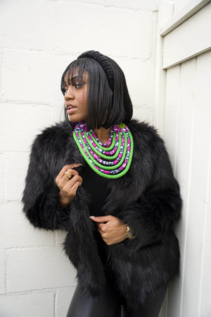 african necklace. african necklace and winter coat