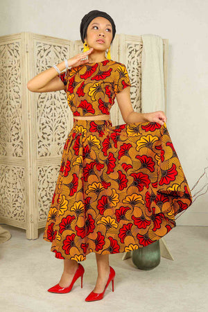 Load image into Gallery viewer, African midi skirt. Fleur de marriage. Africa skirt. Africa print skirt. floral midi skirt. Red and Orange midi skirt. African skirt for women with pockets.