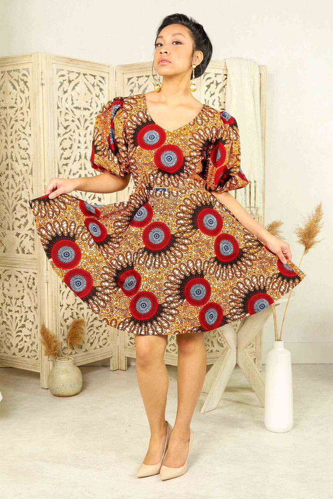 orange african print mini dress with puff sleeves and side pockets.