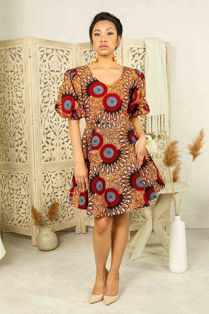 orange african short dress with puff sleeves and side pockets.