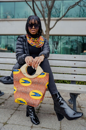 african bag with matching necklace