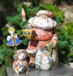 Hand carved hand painted Russian santa, snowman, ornaments