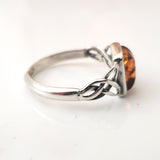 silver celtic ring with amber