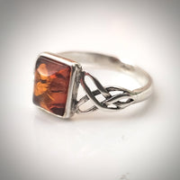 celtic sterling silver ring with baltic amber