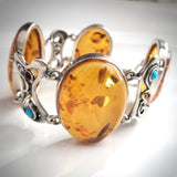 Large oval honey amber link bracelet in sterling silver