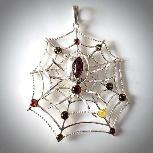 Large spider web silver amber pendant