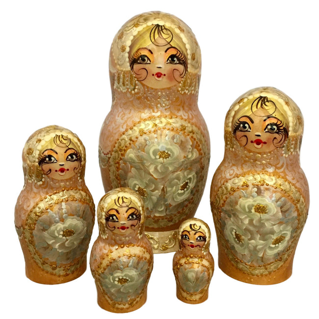 Gold stacking dolls