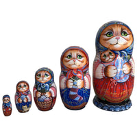 Red kittens Russian nesting box