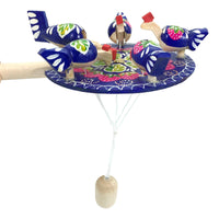Chicken pecking paddle blue