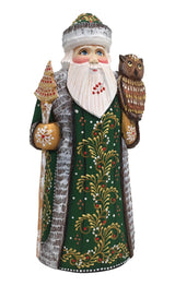 Santa with an owl carved wooden figurine