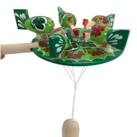 Chicken pecking paddle green