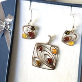 modern amber pendant and earrings set in sterling silver