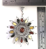 large sun pendant with multicolor amber