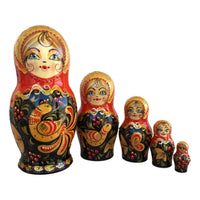 Russian stacking dolls red gold