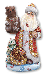 Wooden Santa figure with bear and Christmas tree