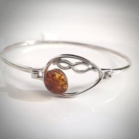 silver cuff bracelet with natural amber