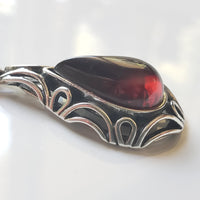 Cherry red amber pendant wth silver