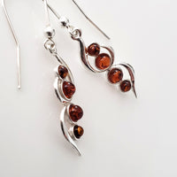Dangle amber earrings with silver