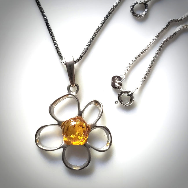 silver flower with chain