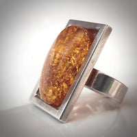 muscular unisex silver amber ring