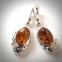 oval cognac amber filigree amber earrings