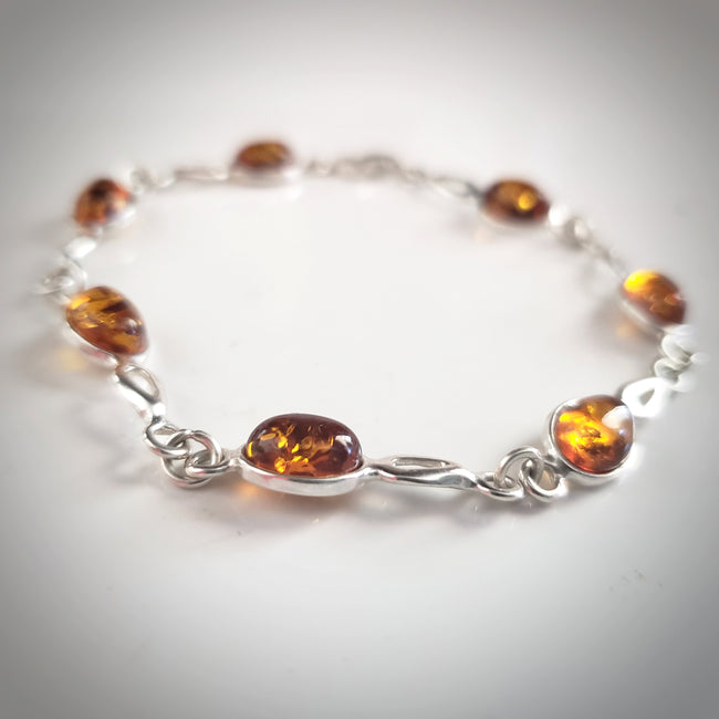 small oval beads honey amber silver link bracelet