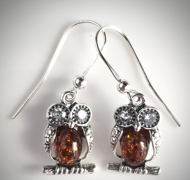 Silver 0wl earrings with crystal eyes and amber