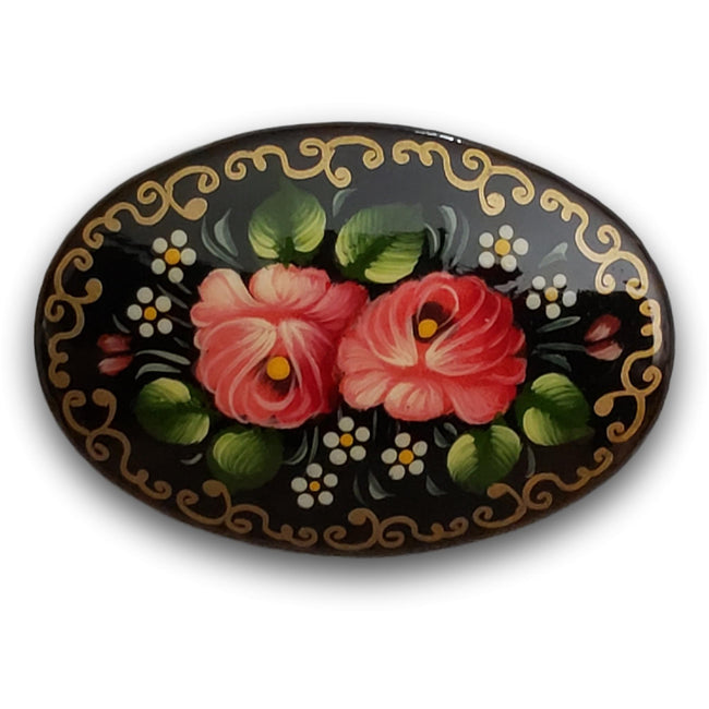 oval handcrafted brooch with pink flowers