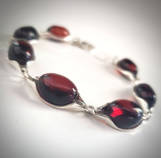 Cherry Red Oval Amber Bracelet Set in Sterling Silver