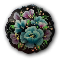 blue flowers painted on black pin