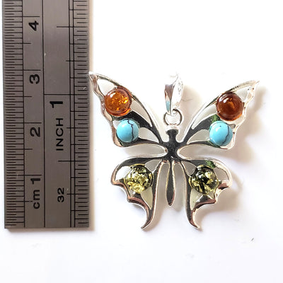 silver butterfly with amber and turquoise beads