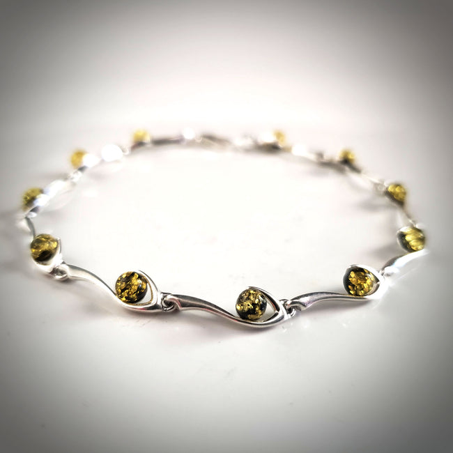 Sterling Silver large bracelet with round green natural amber beads