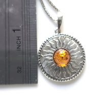 silver sun necklace in box