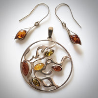 sunburst silver pendant with earrings set