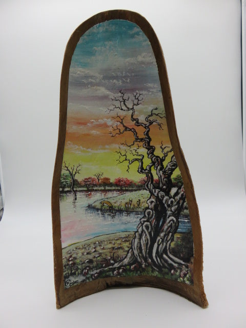 <span style='font-size:1em'>Painting of river & tree<br><span style='font-size:0.7em'>on palm leaf</span>