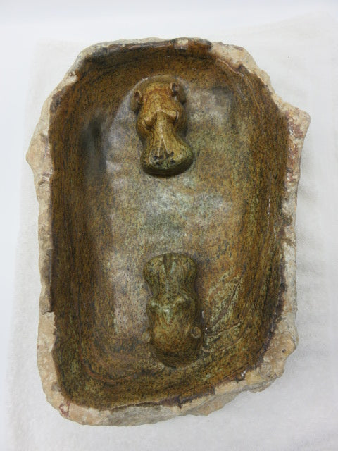 <span style='font-size:1em'>Bird bath</span><br><span style='font-size:0.7em'>Hand Carved Rapoko stone</span>