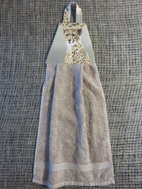 <span style='font-size:1em'>Cheetah Print</span><br><span style='font-size:0.7em'>Kitchen Towel</span>