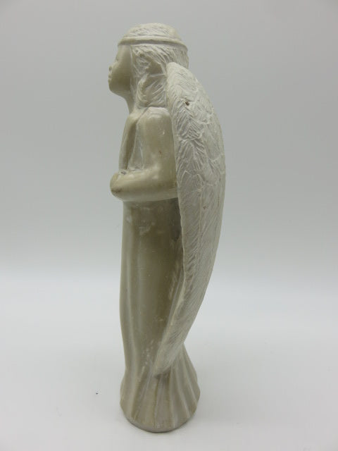 <span style='font-size:1em'>Angel</span><br><span style='font-size:0.7em'>Hand Carved White Opal Stone</span>