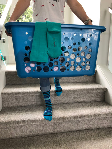 Laundry Bin filled with Dr. Segal's Compression Socks