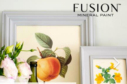 Pictured are two framed botanical prints depicting fruit and flowers. The frames are painted with Pebble Fusion Mineral Paint.