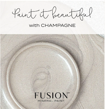 "Pictured is an open container of Champagne Metallic Fusion Mineral Paint. The way the paint is swirled shows off the metallic threads throughout the paint. Over the picture are the words ""Paint it Beautiful with CHAMPAGNE"""