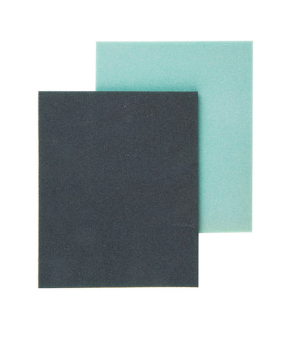 Pictured are two ultra fine sanding pads. One is face up, showing the grey rough side of the pad, and the other is face down, showing the light blue, smooth side of the pad.