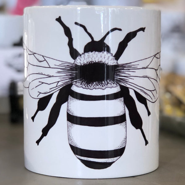 A large white bug with a black bee design.