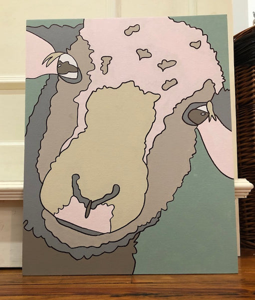 Pictured is a completed Paint-It-Yourself Canvas Kit with the sheep design.